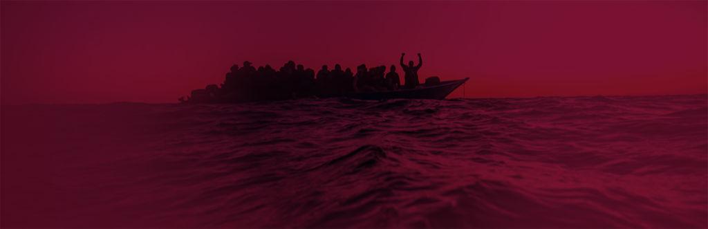 Flyktingar flyr över havet